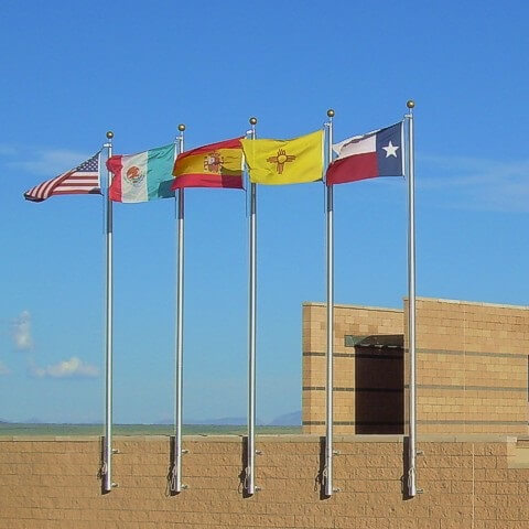 Entrance to El Camino Real Historic Trail Site. The flags are those of Spain, Mexico and the United States, the countries with historic ties to the trail, and New Mexico and Texas, the states the trail travels in the United States, making El Camino Real truly international.<br><br><b>Photo by El Camino Real HTS</b>